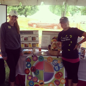 Dietetic interns Erin and Kelly share healthy living tips at the SJMHS tent.