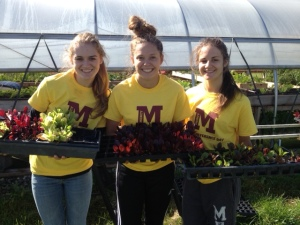 Girls helping water seedlings